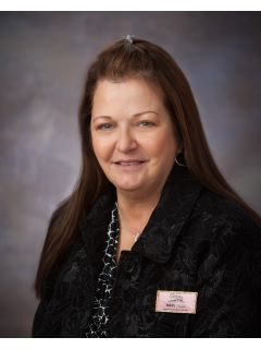Mary Dean of CENTURY 21 Hughes-Riggs Realty, Inc