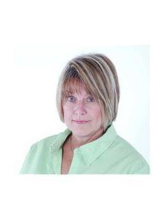 Cheryl Metcalf of CENTURY 21 Blackwell & Co. Realty, Inc.