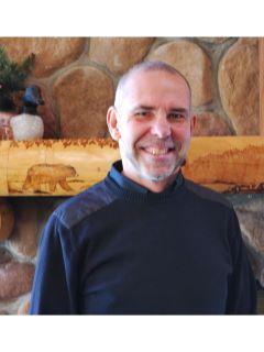 Jim Kerkow of CENTURY 21 Woods To Water Realty
