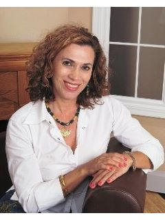 Margarita Roman-Usry of CENTURY 21 Tenace Realty