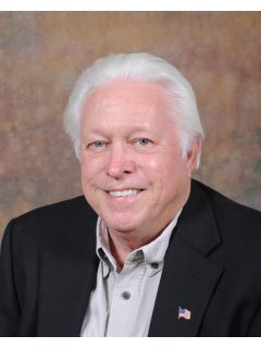 Charlie Simpson of CENTURY 21 Robinson Realty, Inc.